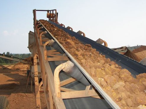 Iron Ore on conveyor belt after being crushed